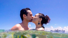 Ex-Chiquititas curte praia de nudismo com o marido e posta foto