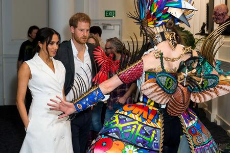 Britain's Prince Harry and Meghan, Duchess of Sussex, meet actors in costumes during a visit to Courtenay Creative, in Wellington, New Zealand October 29, 2018. Dominic Lipinski/Pool via REUTERS