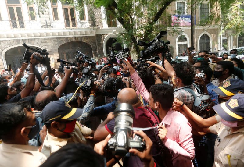 Media personnel surround Bollywood actor Rhea Chakraborty as she arrives at Narcotics Control Bureau (NCB) office for questioning, in Mumbai