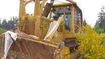 Man Allegedly Destroyed Neighbor's Home with Bulldozer