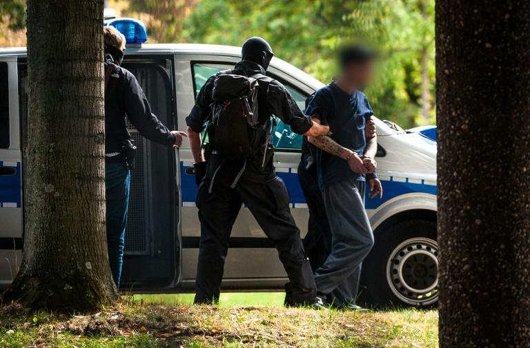 Most of the suspects were arrested in October last year (AFP Photo/Christoph Schmidt)