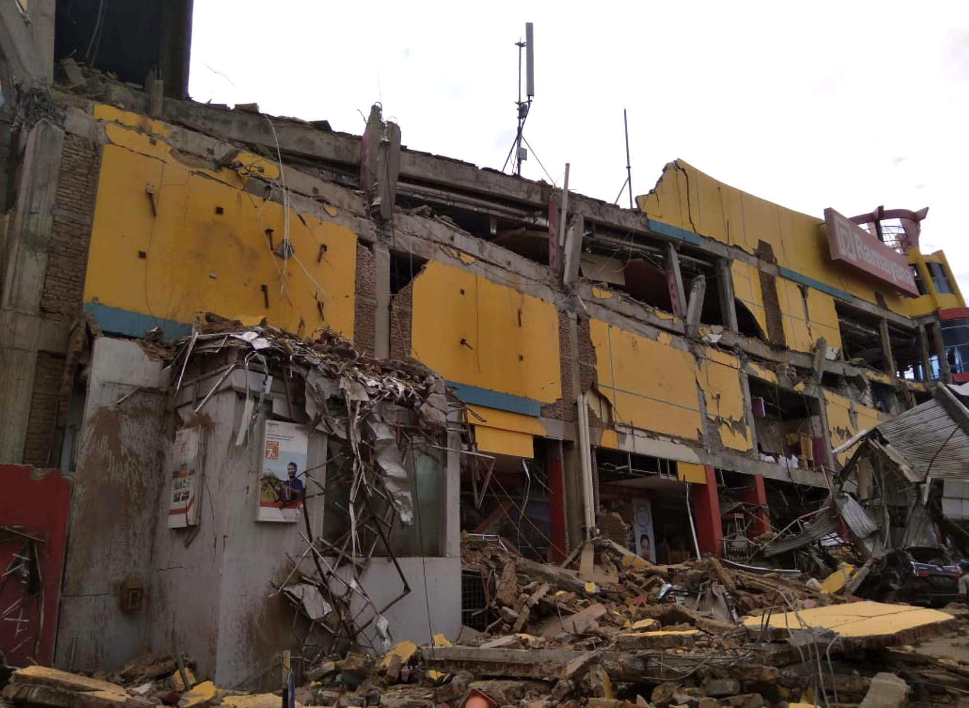 A department store building is seen heavily damaged by earthquake in Palu, Central Sulawesi, Indonesia, Saturday, Sept. 29, 2018. The powerful earthquake rocked the Indonesian island of Sulawesi on Friday, triggering a 3-meter-tall (10-foot-tall) tsunami that an official said swept away houses in at least two cities. (AP Photo/Rifki)