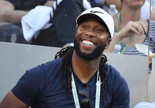 Larry Fitzgerald said he'll address his future plans only once this year. (AP)