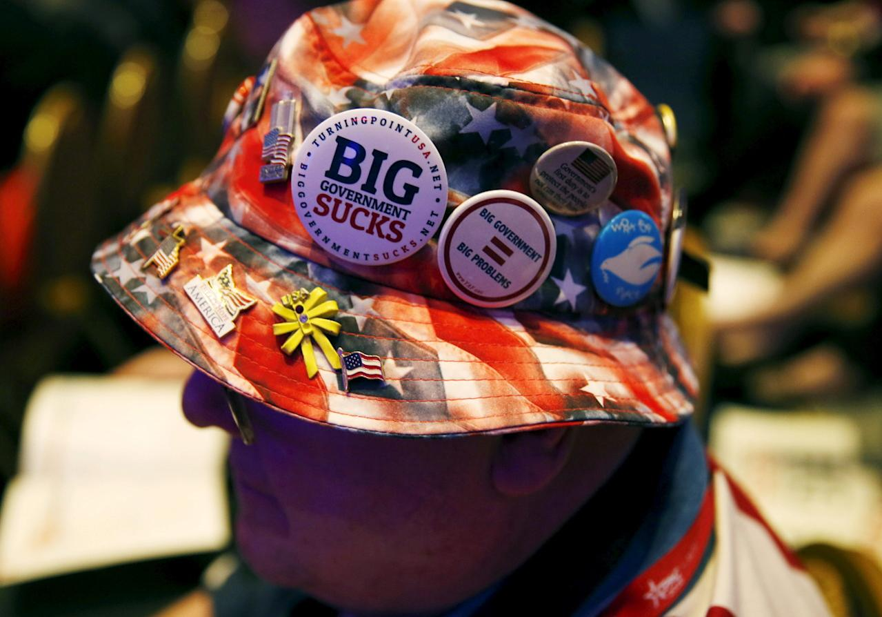 <p>A man displays pins on his hat at the CPAC 2016 annual conference, March 3. <i>(Photo: Gary Cameron/Reuters)</i></p>