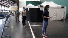 With masks and gel, Spaniards vote amid new coronavirus outbreaks