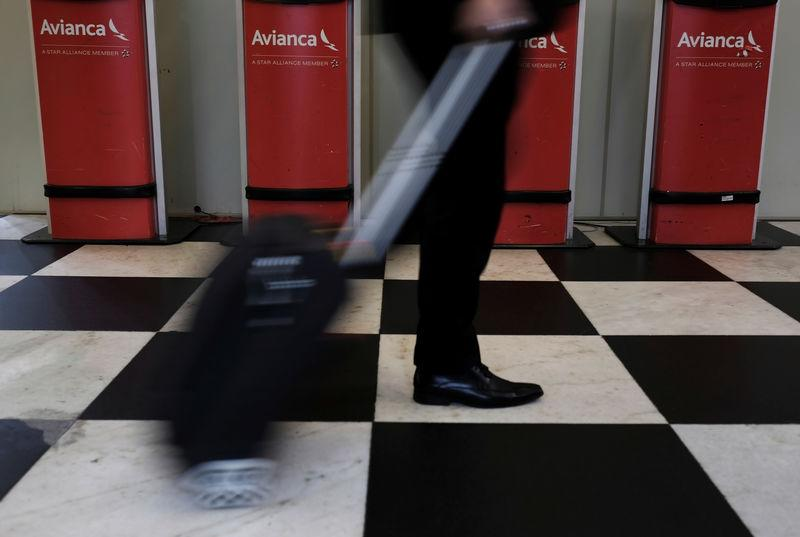 A customer walks past Avianca airline check-in machines at Congonhas airport in Sao Paulo