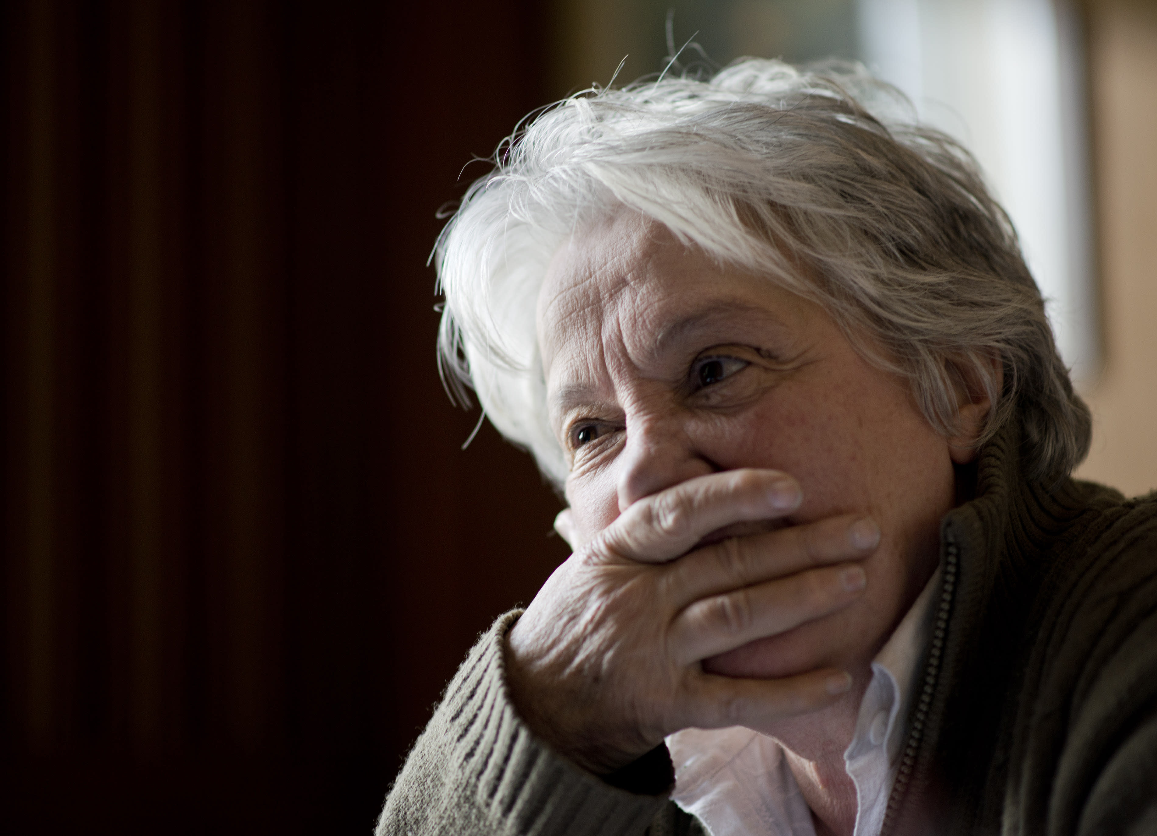 """In this Aug. 26, 2013 photo, first lady and Senator Lucia Topolansky pauses during an interview at her office in Montevideo, Uruguay. As a young woman, a revolutionary, a prisoner and a politician, she said she's always sought """"public happiness."""" (AP Photo/Matilde Campodonico)"""