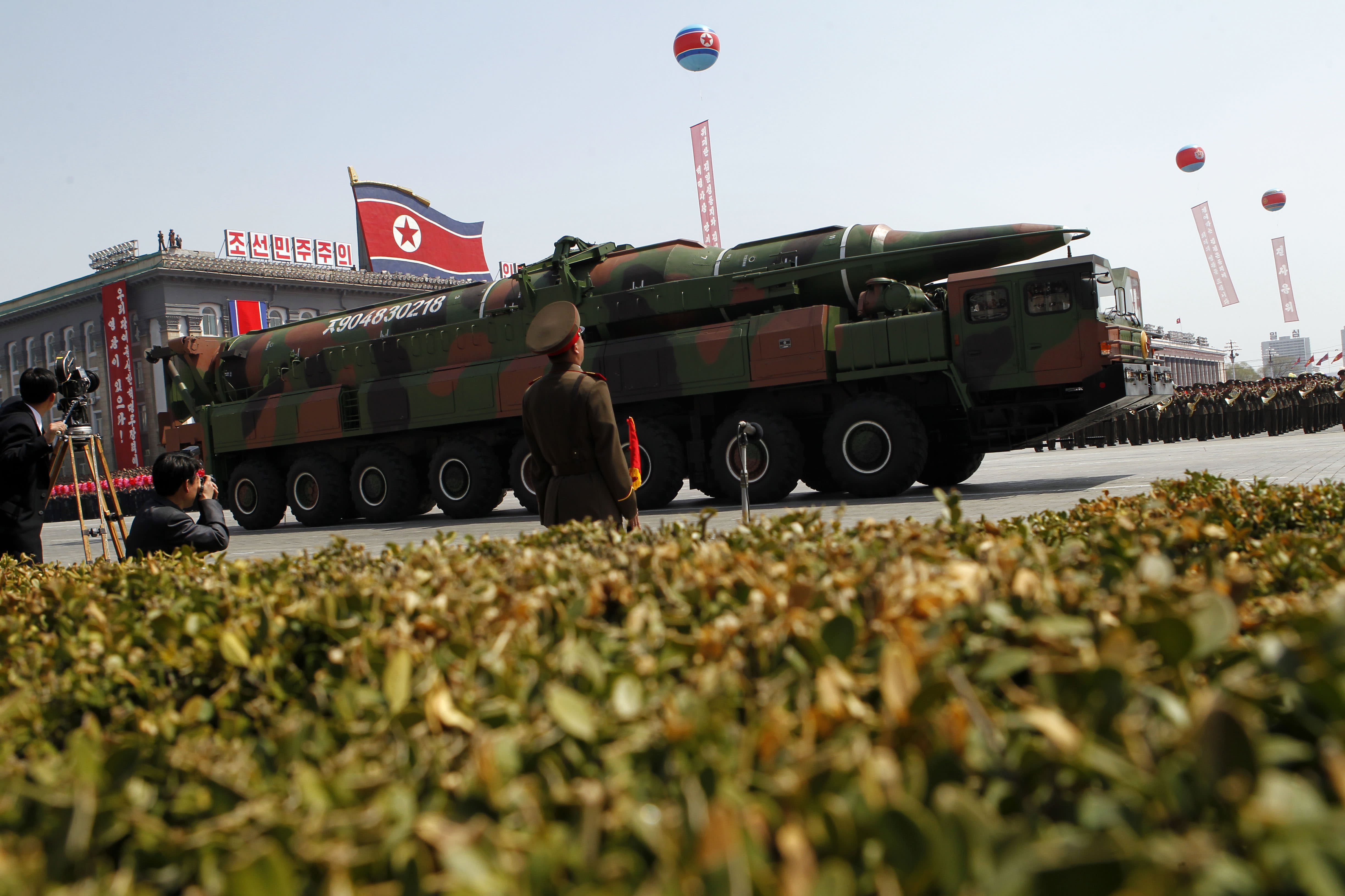 A North Korean vehicle carrying what appears to be a new missile passes by during a mass military parade in the Kim Il Sung Square in Pyongyang, to celebrate 100 years since the birth of the late North Korean founder Kim Il Sung on Sunday, April 15, 2012. North Korean leader Kim Jong Un delivered his first public televised speech Sunday, just two days after a failed rocket launch, portraying himself as a strong military chief unafraid of foreign powers during festivities meant to glorify his grandfather. (AP Photo/Ng Han Guan)