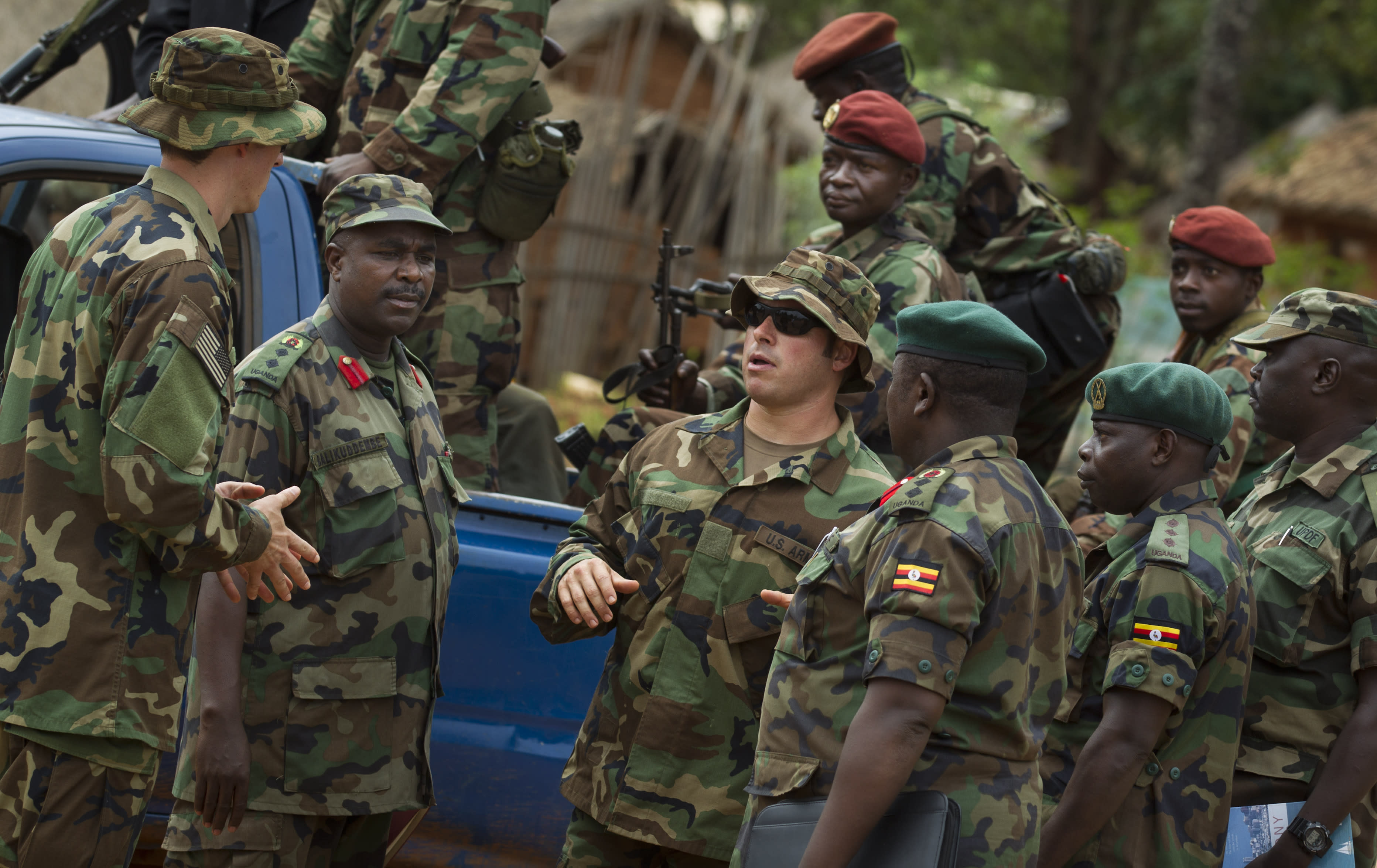 U.S. Army special forces Master Sergeant Eric, center, who would only give his first name in accordance with special forces security guidelines, speaks with troops from the Central African Republic and Uganda, in Obo, Central African Republic, Sunday, April 29, 2012. Obo was the first place in the Central African Republic that Joseph Kony's Lord's Resistance Army (LRA) attacked in 2008 and today it's one of four forward operating locations where U.S. special forces have paired up with local troops and Ugandan soldiers to seek out Kony. (AP Photo/Ben Curtis)