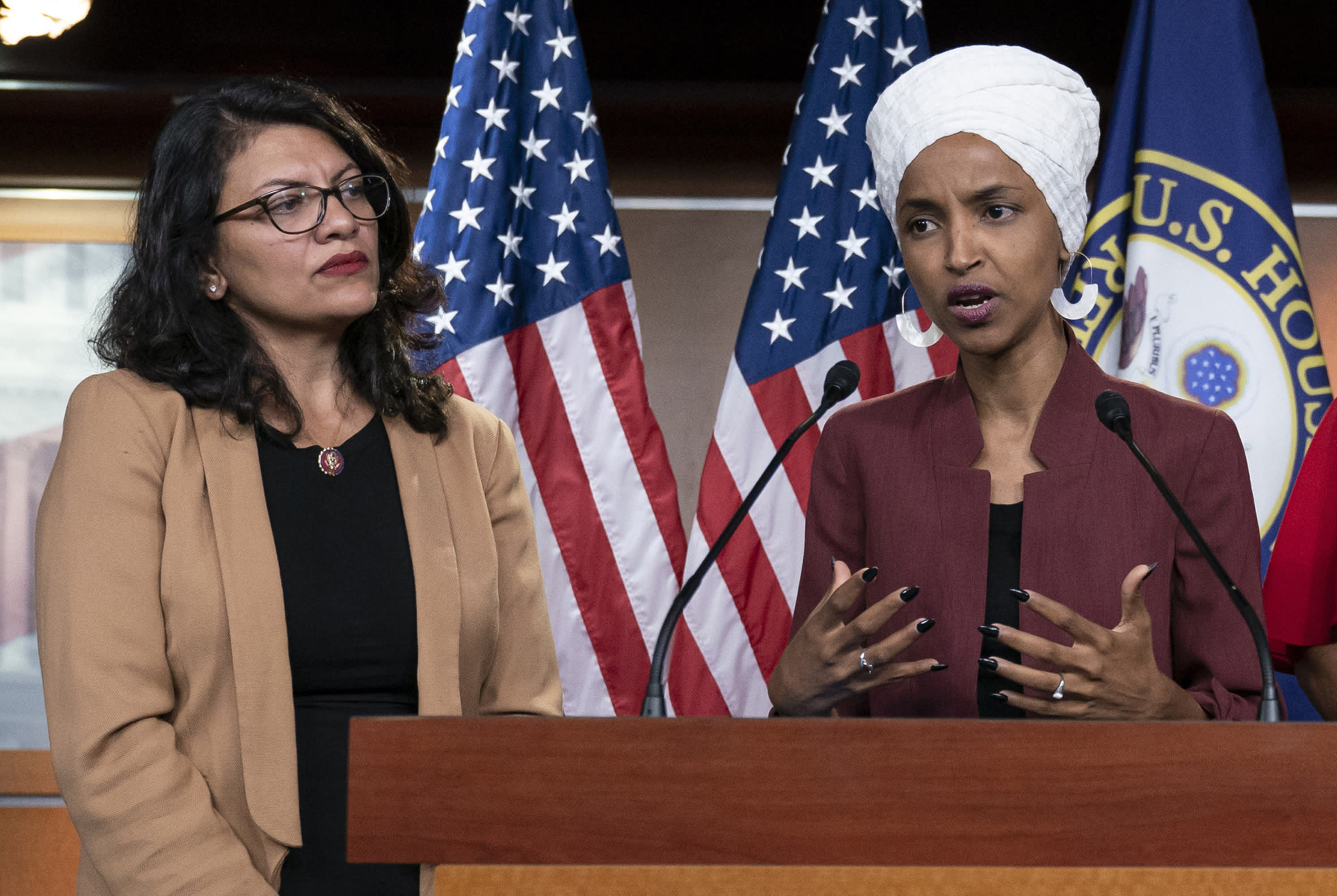 FILE - In this July 15, 2019, file photo, U.S. Rep. Ilhan Omar, D-Minn, right, speaks, as U.S. Rep. Rashida Tlaib, D-Mich. listens, during a news conference at the Capitol in Washington. In the eyes of critics, Benjamin Netanyahu's decision to bar two Democratic congresswomen at the request of President Donald Trump is the latest reckless gamble by a prime minister willing to sacrifice Israel's national interests for short-term gain. And yet the pursuit of such allegedly short-term gains has kept Netanyahu in power for more than a decade. (AP Photo/J. Scott Applewhite, File)