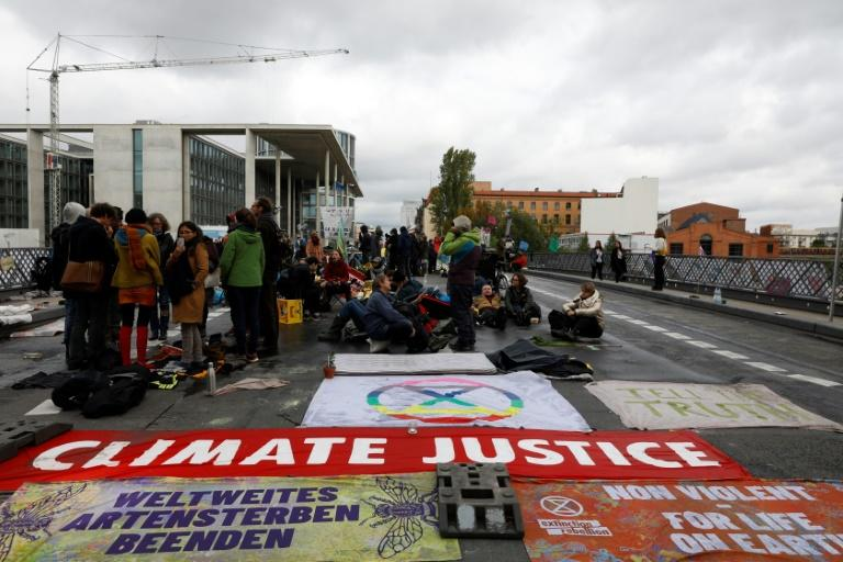 Climate change has become a global rallying cry, with Germany notably seeing large demonstrations such as the Extinction Rebellion protest in Berlin on October 10 (AFP Photo/MICHELE TANTUSSI)