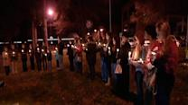 Local candlelight vigil held for Conn. victims