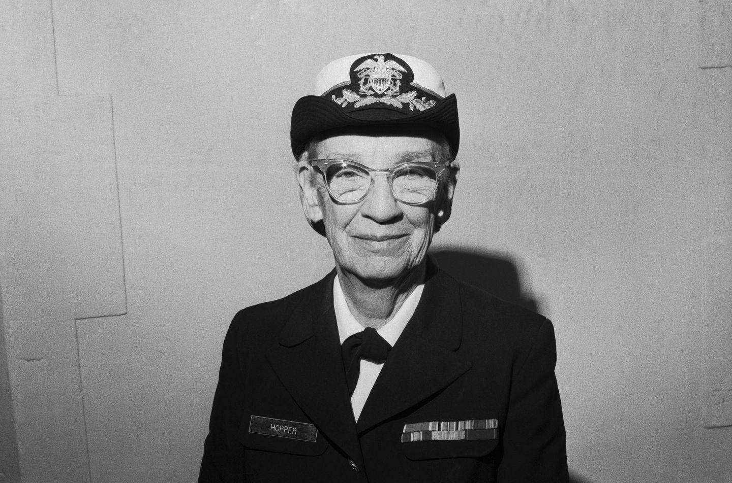 """<p>Mathematician and U.S. Navy Rear Admiral Grace Hopper changed the face of computing as we know it. </p><p>In 1943, Hopper joined the U.S. Naval Reserve, where she was assigned to Harvard University's Bureau of Ordnance Computation Project. There, she began work on the Mark series of computers and coined the term computer """"bug"""" after a moth infiltrated hardware on the Mark I machine. She also worked on the UNIVAC I, the first commercial all-electronic digital computer. </p><p>Hopper went on to work for the Eckert-Mauchly Computer Corp., which was taken over by Remington Rand in 1951 and Sperry Rand Corp. just five years later. Hopper is known for her work with compilers, software that translates programming languages into computing code. </p><p>For example, in 1957, she and her team developed the compiler Flow-Matic, an English-language data-processing compiler. Her translation of complicated systems into easy-to-understand languages made the newly invented technology more accessible.</p>"""