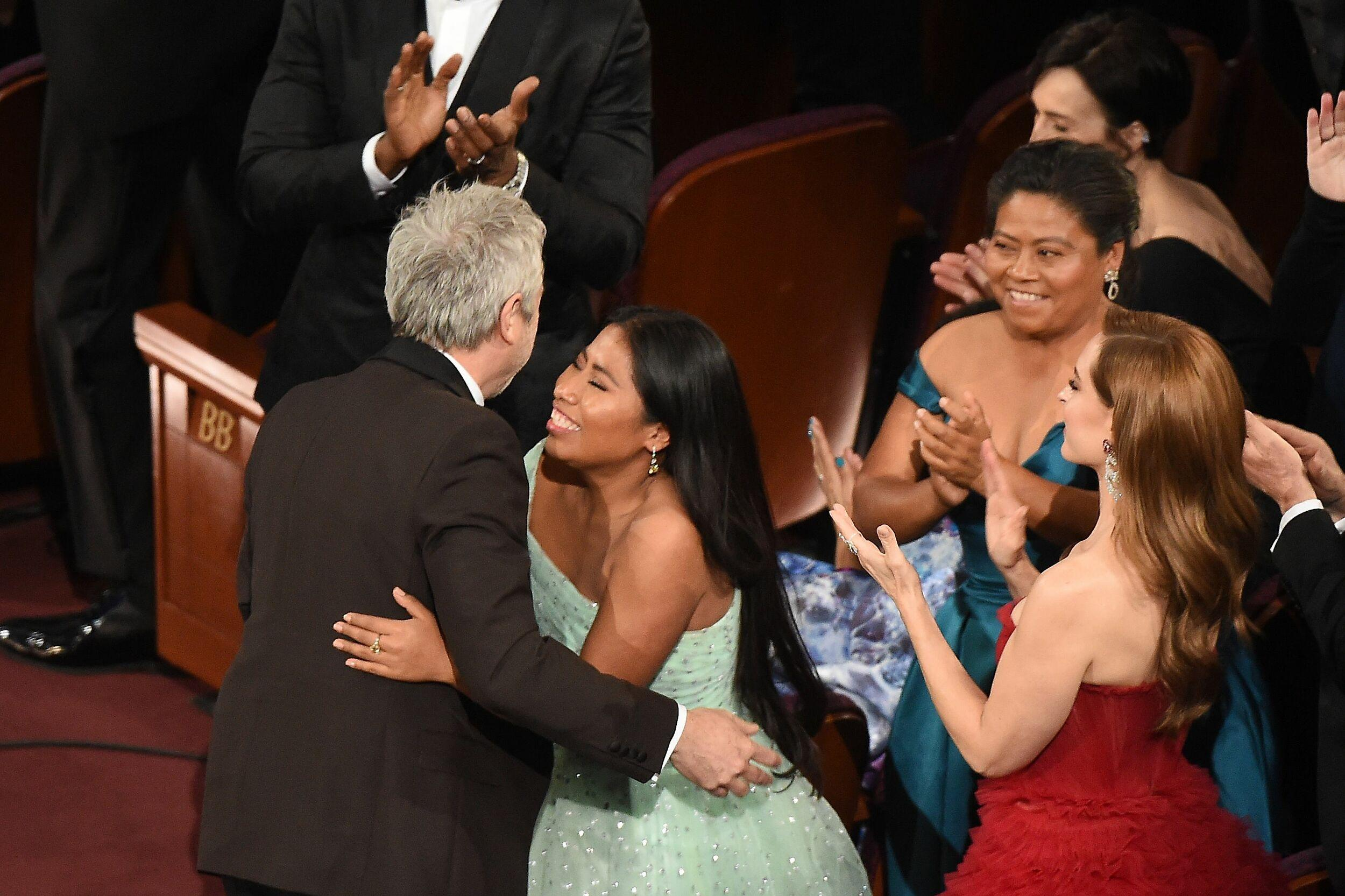 Mexican director Alfonso Cuaron kisses Mexican actress Yalitza Aparicio during the 91st Annual Academy Awards at the Dolby Theatre in Hollywood, California on February 24, 2019. (Photo by VALERIE MACON / AFP)        (Photo credit should read VALERIE MACON/AFP/Getty Images)