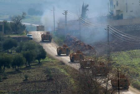 Turkish military armoured vehicles arrive at a border village near the town of Hassa in Hatay province, Turkey. Baris Kadirhan/Depo Photos via REUTERS