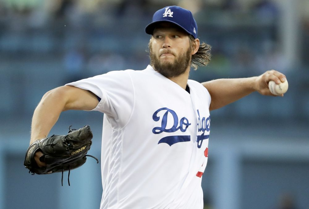 Los Angeles Dodgers starting pitcher Clayton Kershaw throws to the plate during the second inning of a baseball game against the Washington Nationals, Wednesday, June 7, 2017, in Los Angeles.