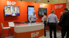 Mining giant BHP pays record dividend, but flags risks to global growth