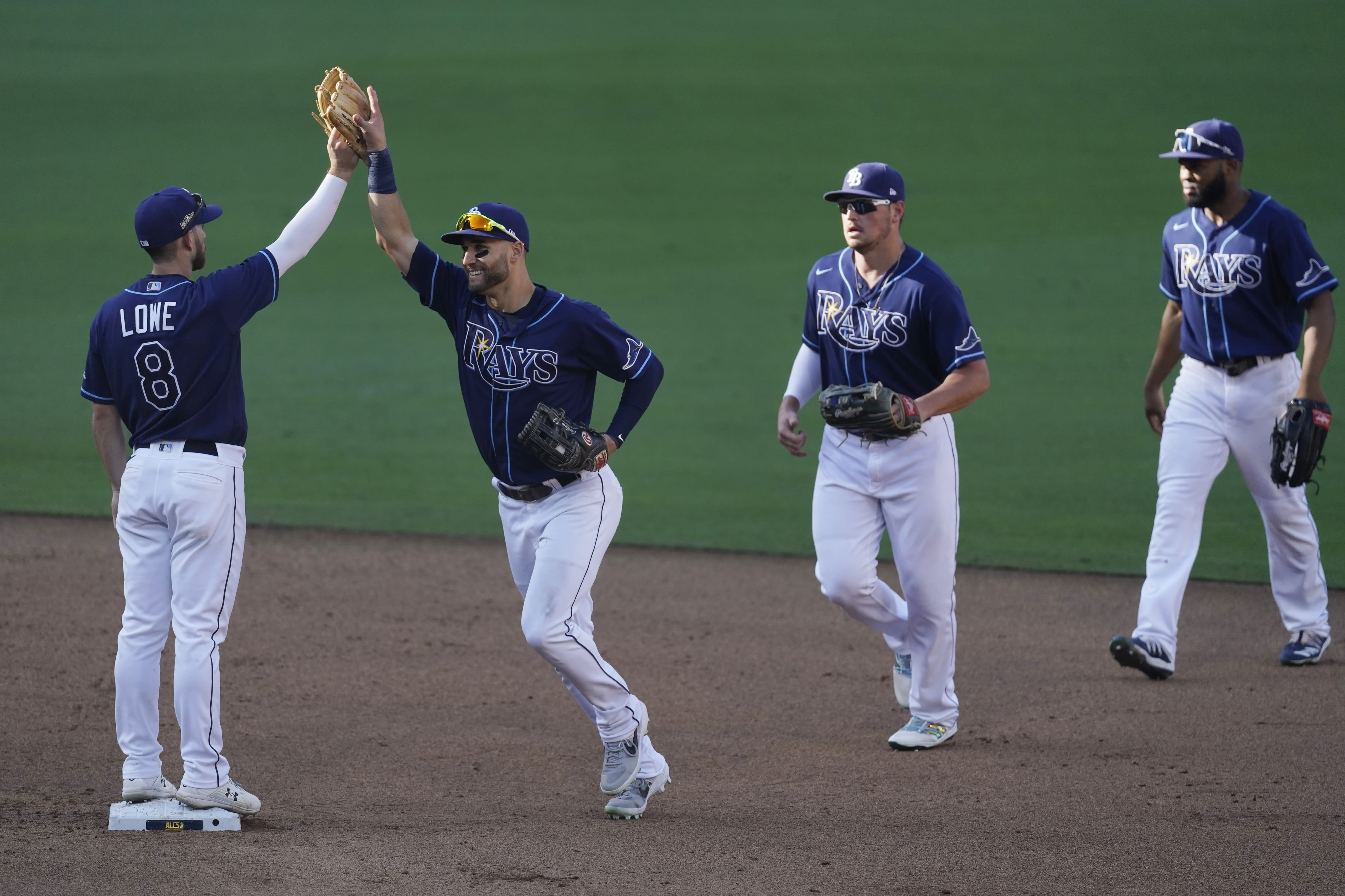 Tampa Bay Rays celebrate their Game 2 victory over the Houston Astros in a baseball American League Championship Series, Monday, Oct. 12, 2020, in San Diego. The Rays defeated the Astros 4-2 to lead the series 2-0 games. (AP Photo/Ashley Landis)