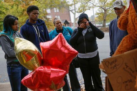 Syreeta Myers, the mother of Vonderrit Myers Jr., grieves next to his makeshift memorial in St. Louis, Missouri