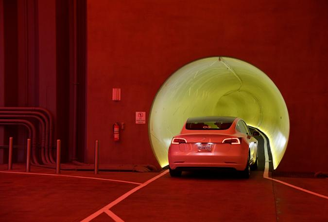 LAS VEGAS, NEVADA - APRIL 09:  A Tesla car drives through a tunnel in the Central Station during a media preview of the Las Vegas Convention Center Loop on April 9, 2021 in Las Vegas, Nevada. The Las Vegas Convention Center Loop is an underground transportation system that is the first commercial project by Elon Musk's The Boring Company. The USD 52.5 million loop, which includes two one-way vehicle tunnels 40 feet beneath the ground and three passenger stations, will take convention attendees across the 200-acre convention campus for free in all-electric Tesla vehicles in under two minutes. To walk that distance can take upward of 25 minutes. The system is designed to carry 4,400 people per hour using a fleet of 62 vehicles at maximum capacity. It is scheduled to be fully operational in June when the facility plans to host its first large-scale convention since the COVID-19 shutdown. There are plans to expand the system throughout the resort corridor in the future.  (Photo by Ethan Miller/Getty Images)