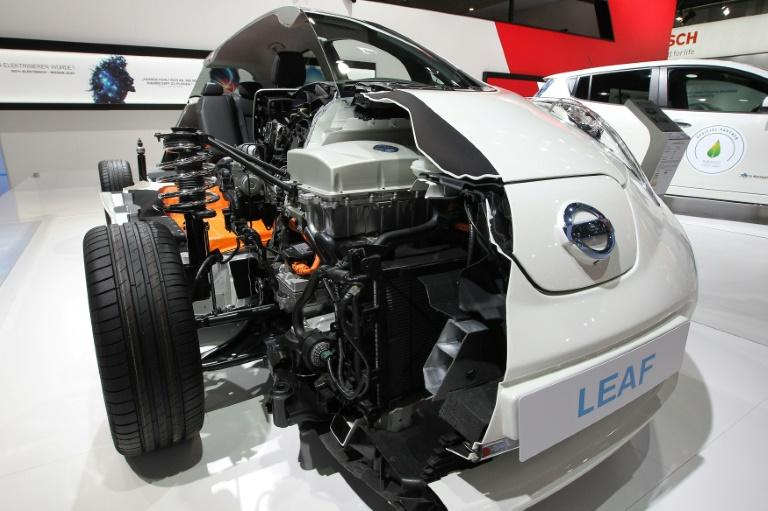 A model shows the insides of a Nissan Leaf electric car (AFP Photo/DANIEL ROLAND)