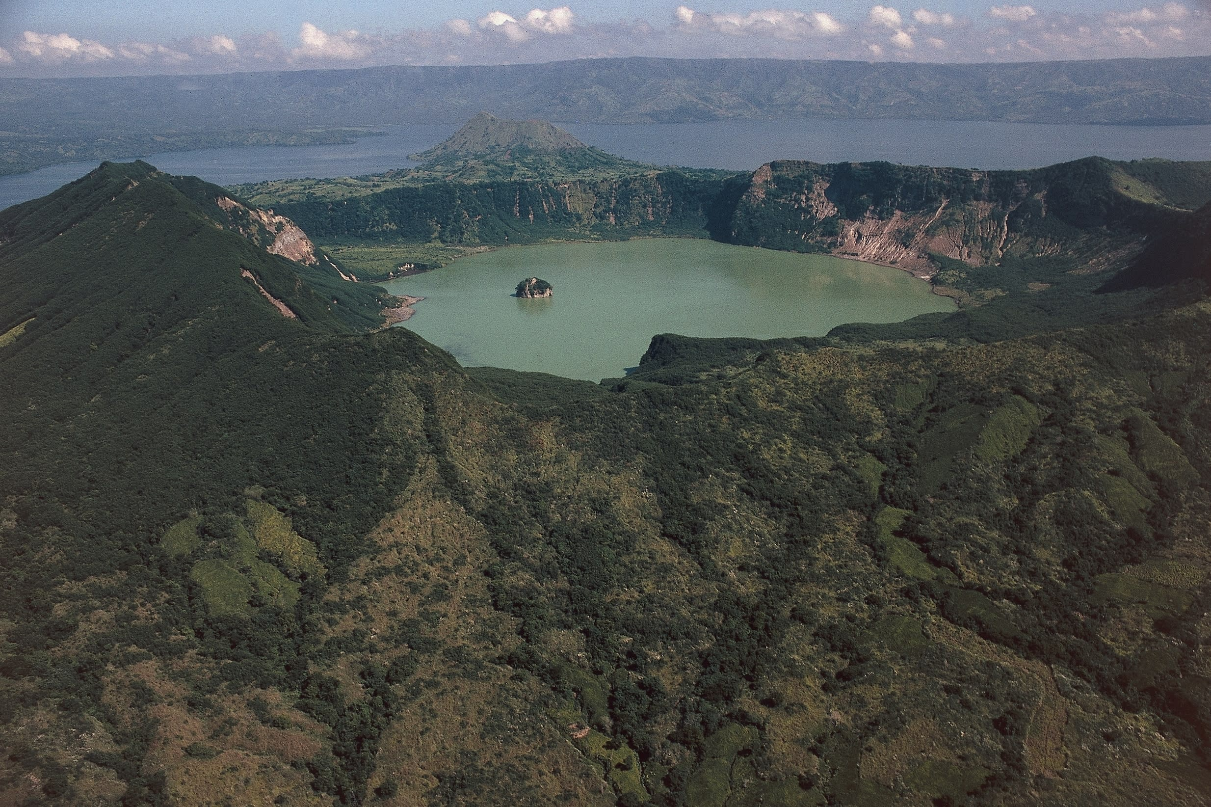 The lake on Taal Volcano on the island of Luzon in the Philippines is where you will find Vulcan Point, the world's largest island within a lake on an island within a lake on an island. Volcano Island, where Vulcan Point is found in a crater lake, is the smallest active volcano in the world and its unexplained shape and location on an island within a lake within an island, makes it a unique geologic wonder.