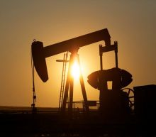 Oil climbs after sharp drop in U.S. crude stocks; OPEC committee meeting in focus
