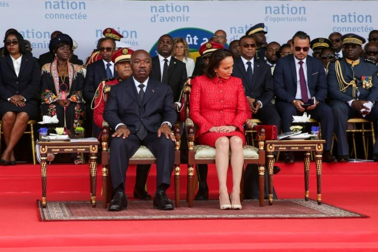 Gabon's President Ali Bongo and the First Lady attend a ceremony in August 2019. Bongo's then cabinet director Brice Laccruche Alihanga is second to the right behind the presidential couple (AFP Photo/Steve JORDAN)