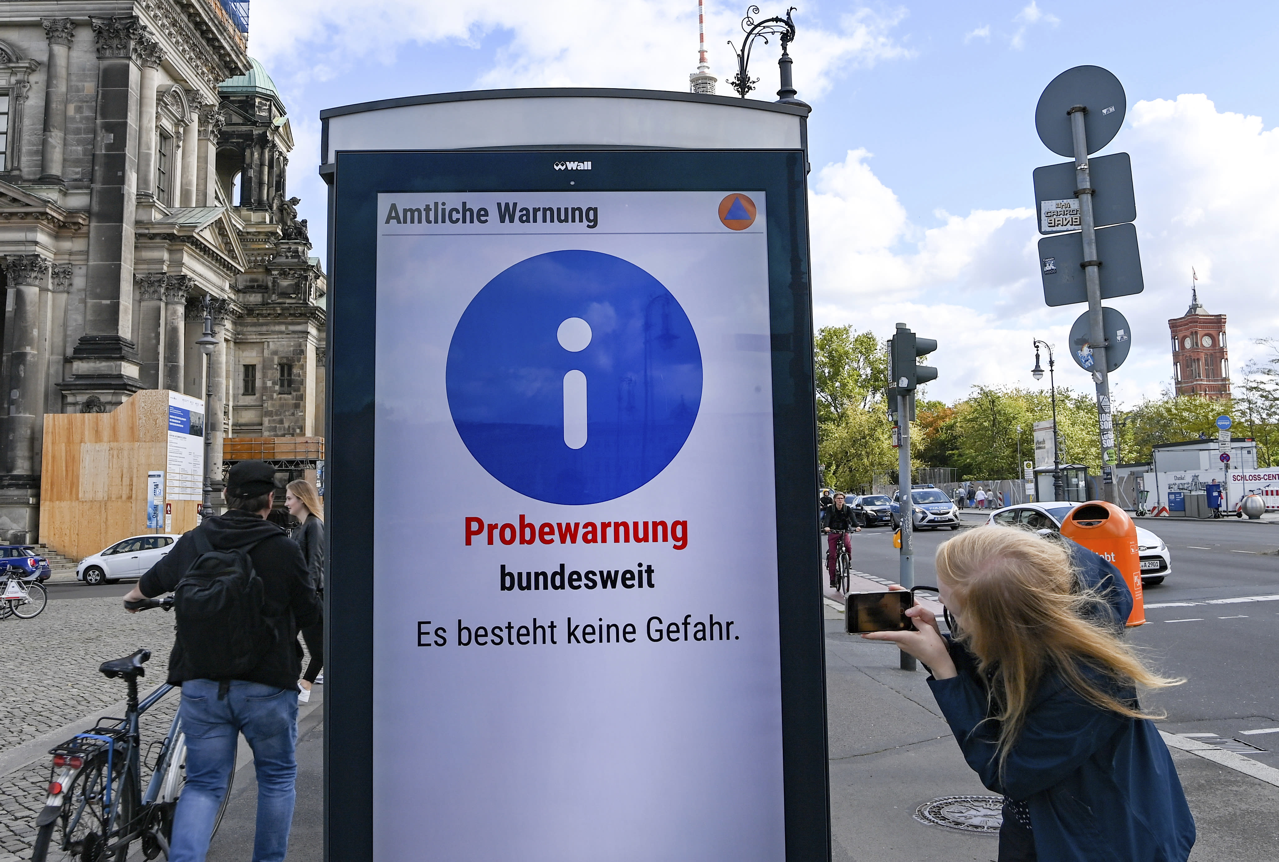"""""""Trial warning nationwide. There is no danger"""" is written at the first nationwide warning day on an information board in Berlin, Germany, Thursday, Sept. 10, 2020. For the first time in 30 years, Germany was planning a nationwide test of sirens on Thursday morning _ only the alarm didn't go off in some places and push alerts never arrived or popped up late on many users' smart phones. (Jens Kalaene/dpa via AP)"""