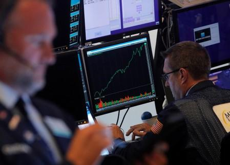 S&P edges lower as Apple weighs, trade tensions ease