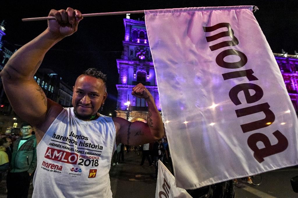 "Thousands of ecstatic Lopez Obrador supporters flooded the capital's central district, chanting ""Yes we did!"" and partying to mariachi music (AFP Photo/ULISES RUIZ)"