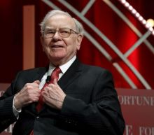 Stock gains power higher Berkshire profit, Buffett presses on with stock buybacks