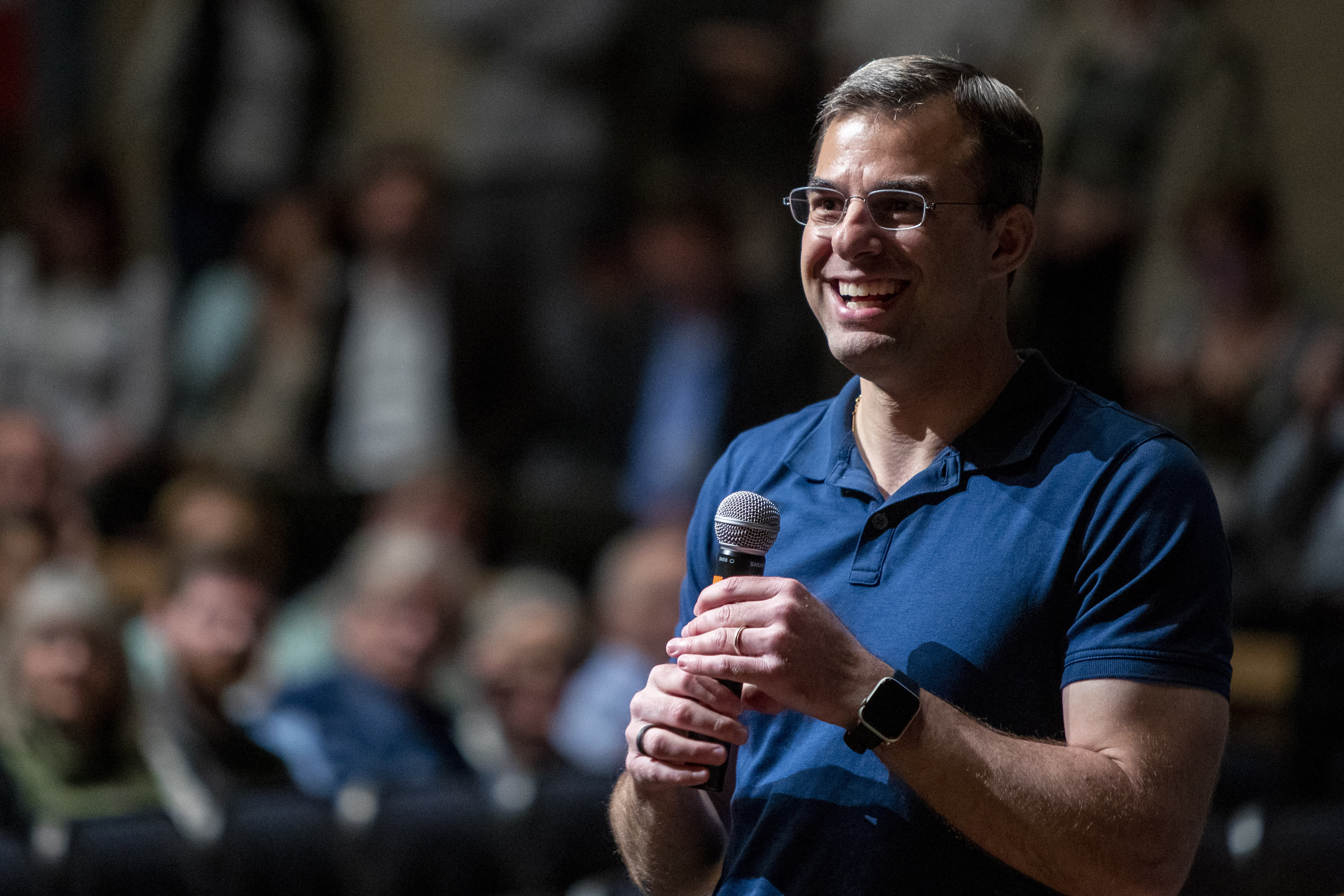 U.S. Rep. Justin Amash, R-Cascade Township, holds a town hall meeting at Grand Rapids Christian High School's DeVos Center for Arts and Worship on Tuesday, May 28, 2019. The congressman came under scrutiny May 18 when he posted a series of Tweets to outline his support for impeachment proceedings. As such, he is the only Republican congress member to do so. The following days brought an announcement from the wealthy DeVos family about no longer supporting him financially. (Cory Morse/The Grand Rapids Press via AP)