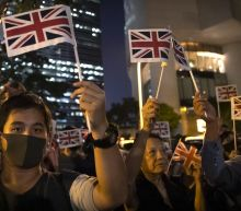 The Latest: Hong Kong protesters rally at British Consulate