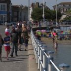 Britons flock to Weymouth beach as UK set for record-breaking heatwave
