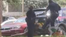 Atlanta police officer suspended after video appears to show him kicking handcuffed woman in the head