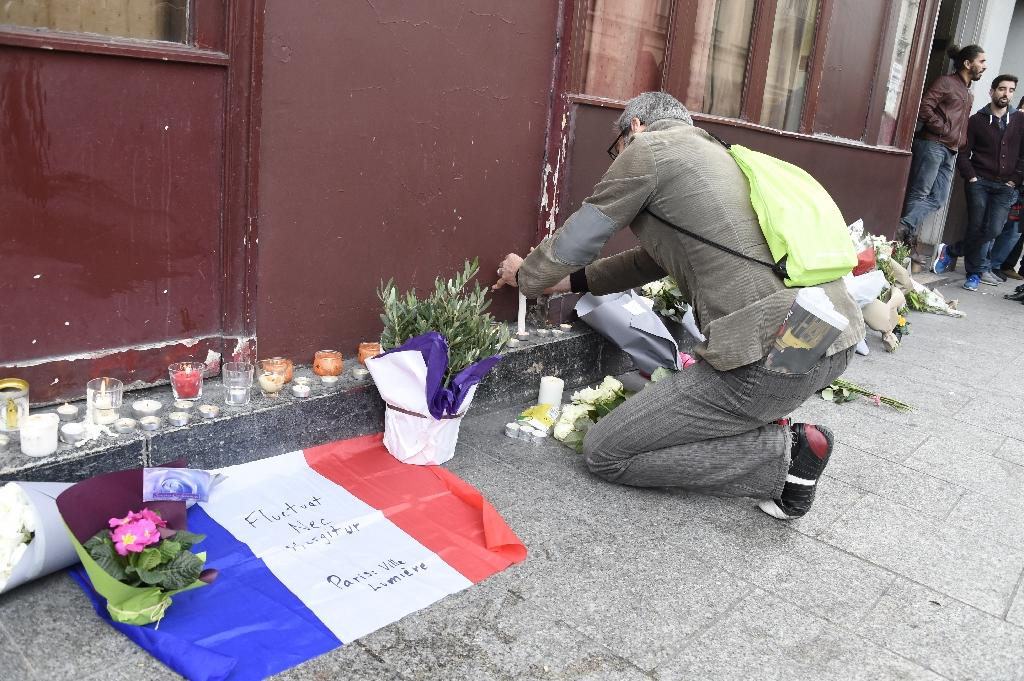 Flowers are laid outside of the Carillon bar in the 10th district of Paris on November 14, on the morning after a series of coordinated terror attacks that killed at least 128 people