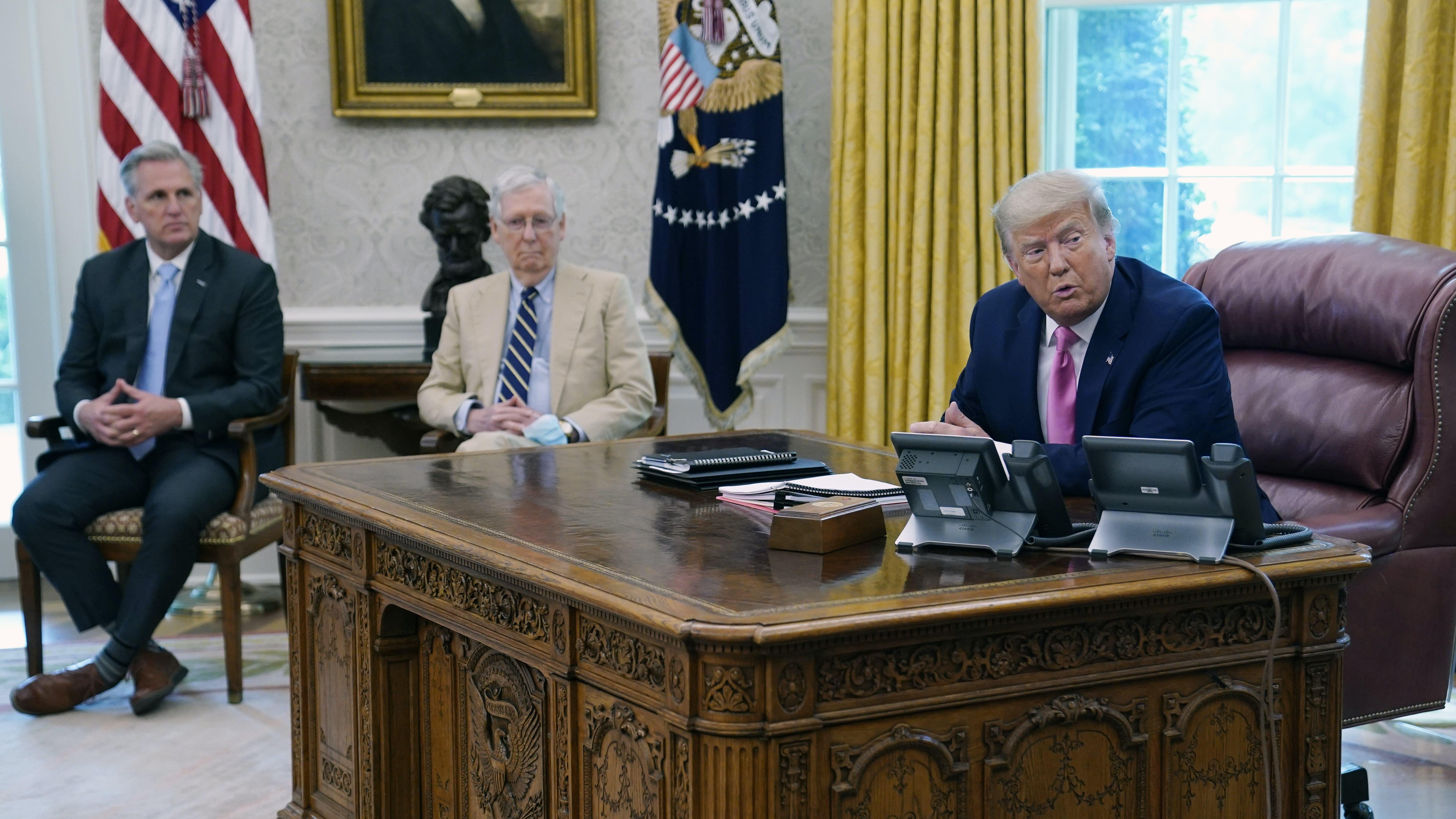 Trump, Congress battle over more virus aid as crisis worsens