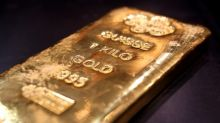 Gold falls 1% as U.S. Fed tempers aggressive rate cut hopes