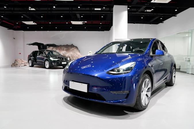 SHANGHAI, Jan. 18, 2021 -- A Tesla Model Y vehicle is pictured at a Tesla Center in east China's Shanghai, Jan. 18, 2021.   U.S. electric carmaker Tesla Inc. on Monday began Shanghai deliveries of its built-in-China Model Y.    On Jan. 7, 2020, Tesla launched the project to manufacture Model Y vehicles in its Shanghai Gigafactory, its first overseas plant outside the United States. The China-made model went on sale on Jan. 1. (Photo by Ding Ting/Xinhua via Getty) (Xinhua/Ding Ting via Getty Images)
