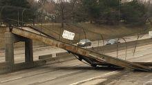 Pedestrian bridge falls onto Detroit freeway after collision