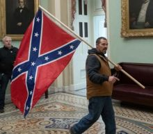 FBI says over 100 people arrested for Capitol siege, including 'liberal activist,' Confederate flag bearer