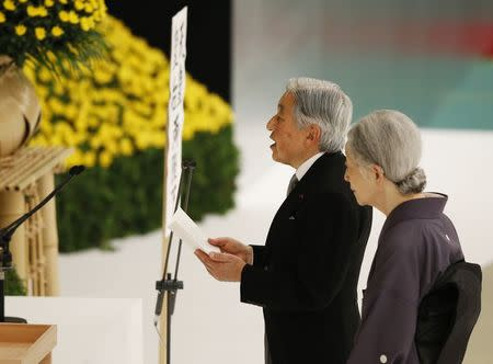 Japan's Emperor Akihito delivers a speech next to Empress Michiko after they offer a moment of silence to the war dead during a memorial service ceremony in Tokyo
