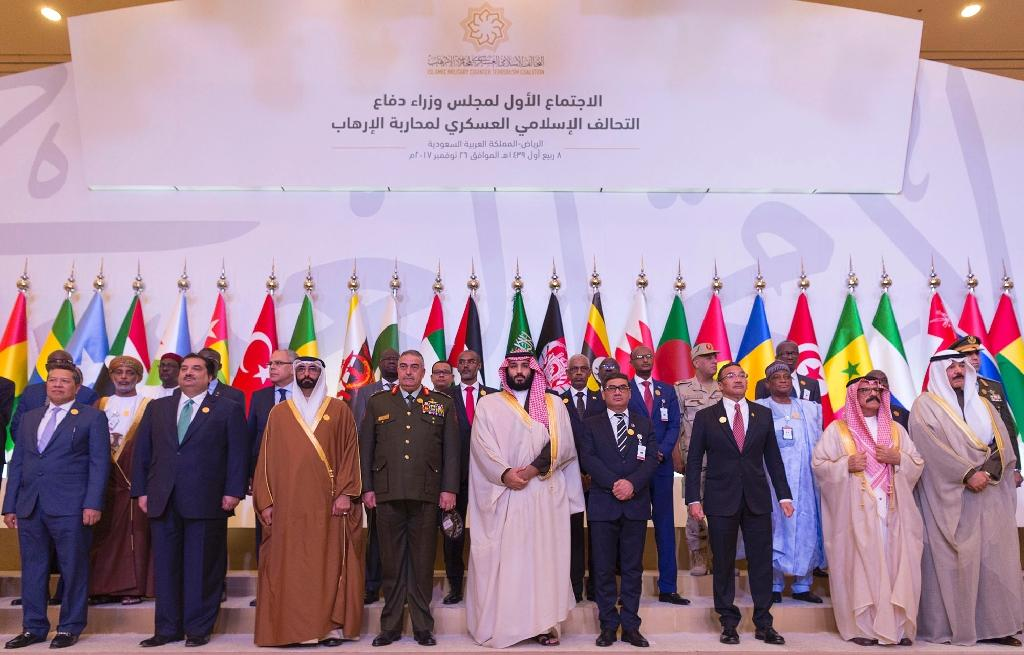 A handout picture from the Saudi palace shows Saudi Crown Prince and Defence Minister Mohammed bin Salman (C) posing with defence ministers from the 41-member Saudi-led Muslim counter-terrorism alliance in Riyadh on November 26, 2017