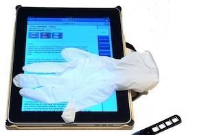 iPads join tongue depressors and latex gloves as a hospital fixture