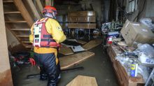 Coffins float in water at flooded funeral parlour after deluge hits swathes of England