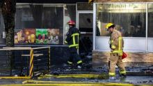 Businesses damaged, stretch of Cambie Street closed after overnight fire in Vancouver