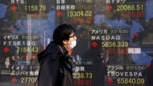 Asian shares edge up, buoyant euro holds its gains