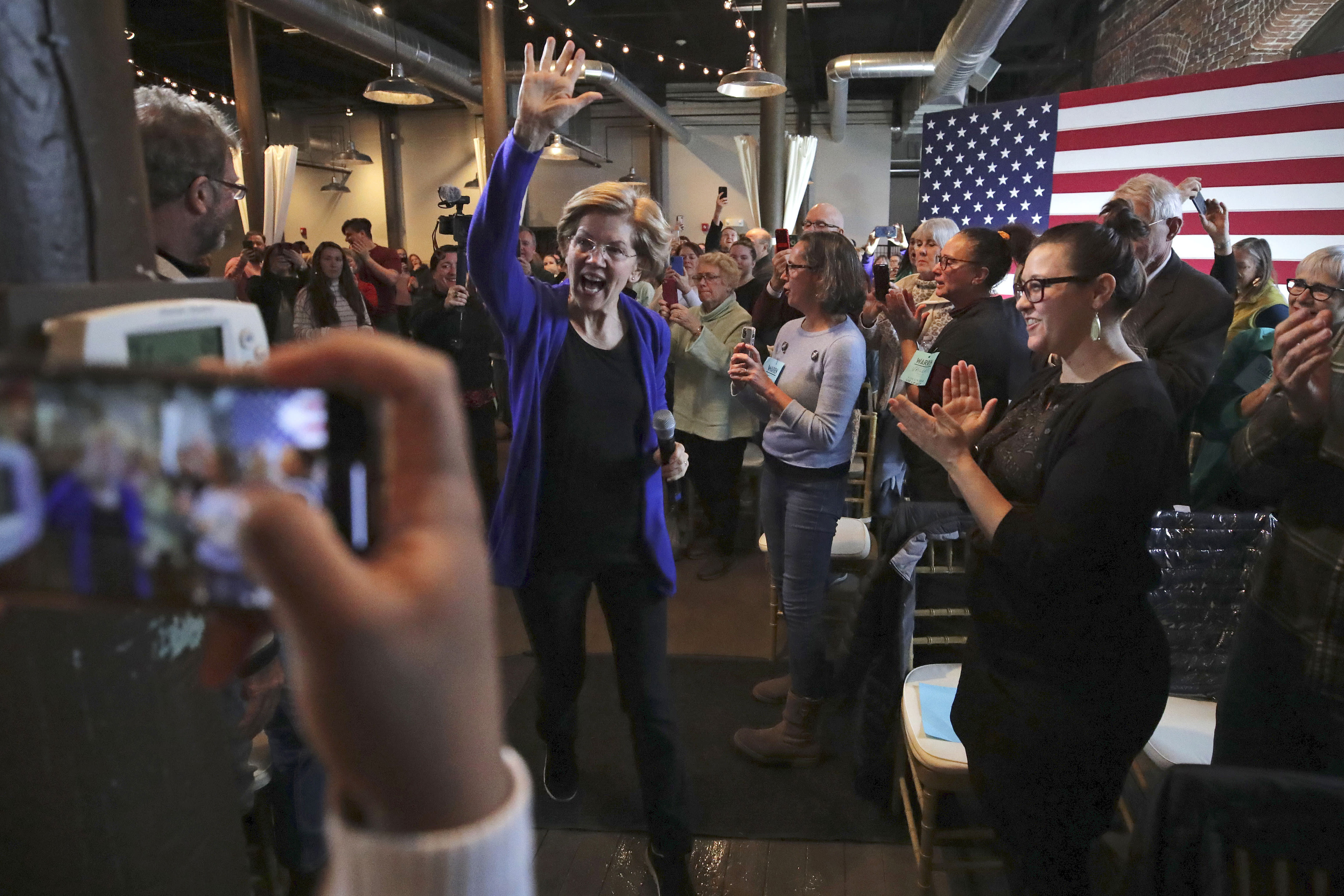 Democratic presidential candidate Sen. Elizabeth Warren, D-Mass., waves as she is introduced at a campaign stop in Dover, N.H., Friday, Jan. 10, 2020. (AP Photo/Charles Krupa)