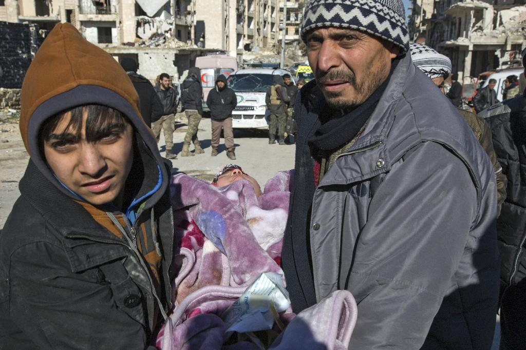 A Syrian child is carried during an evacuation operation of rebel fighters and their families from rebel-held neighbourhoods on December 15, 2016 in the embattled city of Aleppo (AFP Photo/KARAM AL-MASRI)